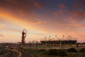 The sun rising over the Olympic Stadium in the Queen Elizabeth Olympic park, London – one year on from Olympic games, Sunday 4 August 2013.