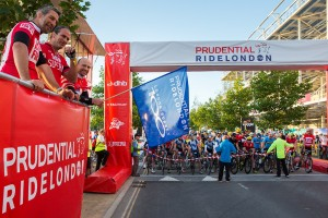 Simon Shaw, Martin Johnson and Matt Dawson start the Prudential RideLondon 100 mile amateur sportive. Queen Elizabeth Olympic Park, ahead of Sunday 2 August 2015. Photographer: Stuart Stevenson