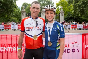 Adrian Trott, and daughter Laura – Finish line, Prudential RideLondon 100 mile amateur sportive. Queen Elizabeth Olympic Park, ahead of Sunday 2 August 2015. Photographer: Stuart Stevenson